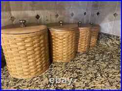Longaberger Basket Canister Set With Sealed Plastic Inserts and lids
