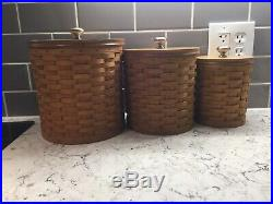 Longaberger Canister Set of Three with inserts. Slightly used condition